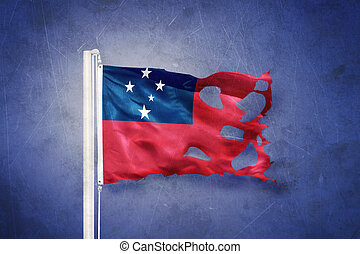 Torn flag of Samoa flying against grunge background.