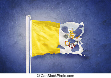 Torn flag of Vatican City flying against grunge background