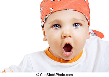 Scream of baby boy with surprise expression on face