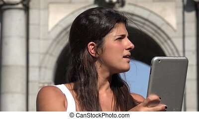 Woman Using Tablet On Vacation