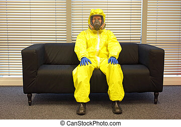 professional in protective clothing, mask and gloves,sitting...