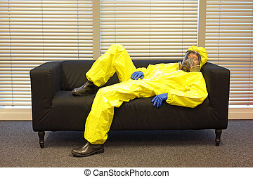 professional in protective clothing, mask and gloves,...