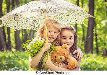 lovely girls holding teddy bear and umbrella - two beautiful...