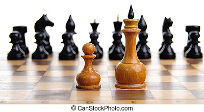 Defeat - Struggle of two white chess figures and black...
