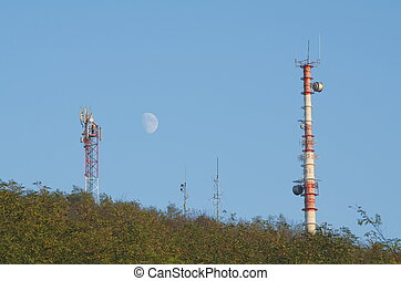 Telecommunications Antennas in the Forest with Clear Blue...