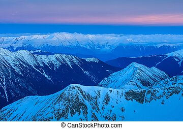 Fagaras Mountains in winter, Romania - after sunset in the...