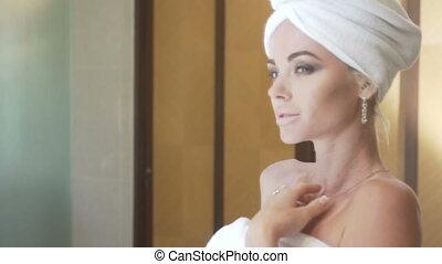 Sensual woman in her bathroom - Mirror reflection of sensual...