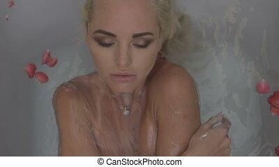 Sensual woman in her bathroom - Closeup portrait of sensual...