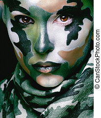 Beautiful young fashion woman with military style clothing...