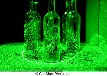Glass bottle in laser lights. - Glass bottle in abstraction...