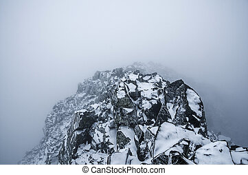 Stormy Mountain Top - the summit of Blanca Peak in a...