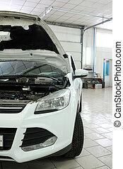 car repair station - Car in a car repair station