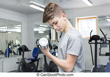 Teenage boy engaged in the gym hall