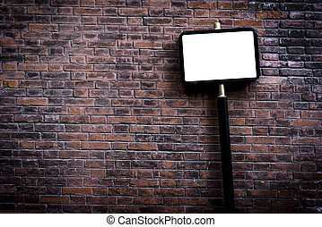 Blank street sign on brick background,selective focus