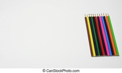 The hand moved a set of pencils from the right corner of the center, close-up