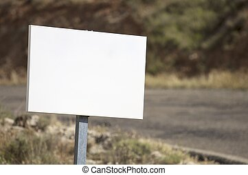 white sign - view of a rectangular white sign at the edge of...