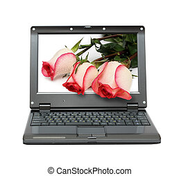 laptop with roses bouquet