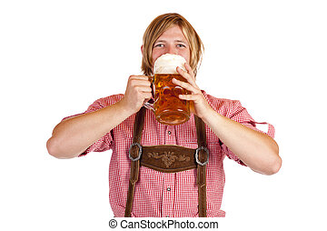 Happy Bavarian man drinks out of oktoberfest beer stein....