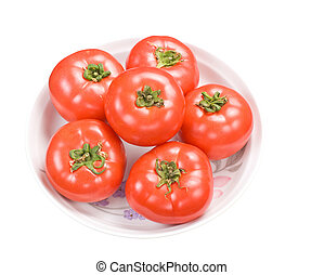 Red fresh tomatoes in dish
