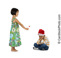 girl giving x-mas gift to boy - a little girl giving her...