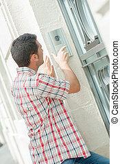 Man pressing an intercom button