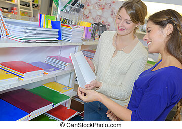 Women looking at books in stationery shop