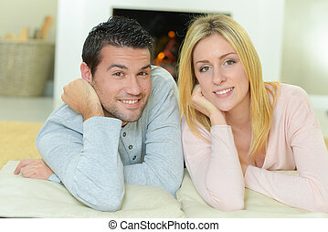 Couple sat by the fire place