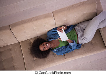 african american woman at home with digital tablet top view...