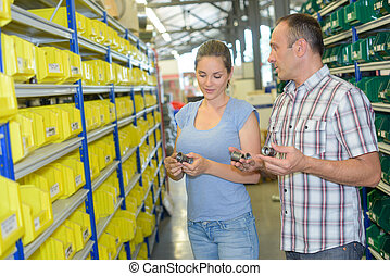Man and woman selecting parts in stores