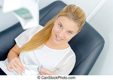 Woman sat in a dentist chair