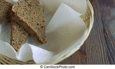 Basket with three pieces of bread - Close-up of basket with...