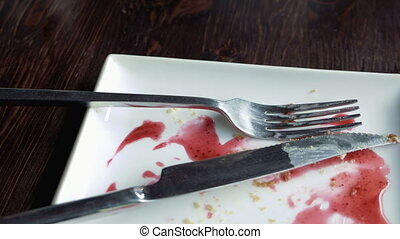Empty plate smeared with fruit syrup - Close-up of empty...
