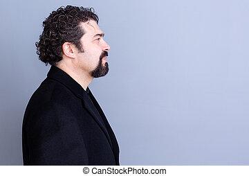 Calm man profile over gray background - Profile of calm...