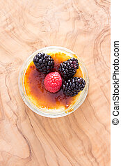 Delicious custard bowl with raspberries