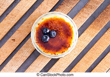 Above view of delicious custard and blueberries - Above view...