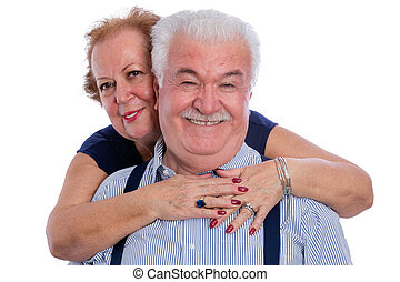 Smiling senior woman embracing her husband
