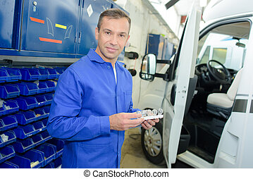 camper van mechanic in the garage