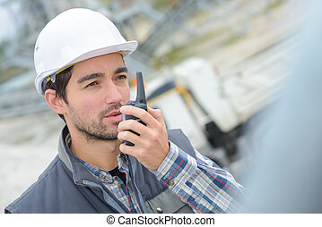 worker on the walkie-talkie