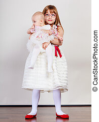 Two little sisters portrait. - Sisterly love. Two lovely...