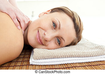 Portrait of a relaxed woman lying on a massage table