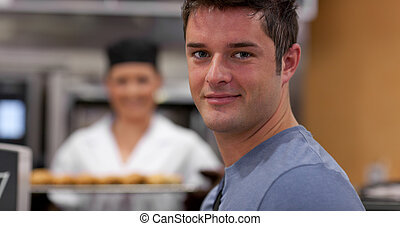 Handsome male customer in a bakery