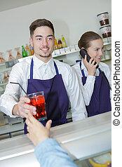 waiter serving drinks