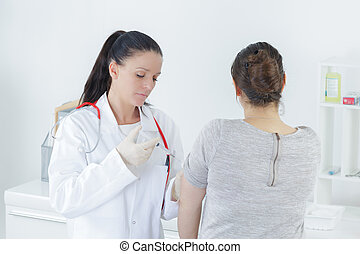 doctor injecting patients hand