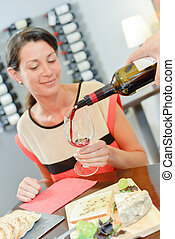 Lady having wine poured for her