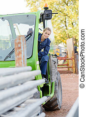 Woman operating telehandler