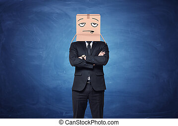 Businessman is wearing cardboard box on his head with...