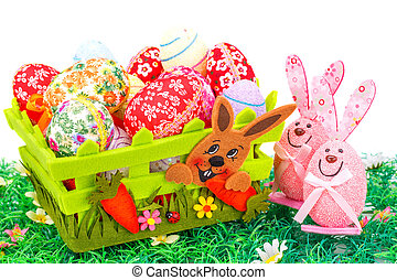 Easter decoration with colorful eggs in basket and bunnies...