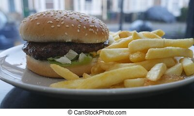 Fast food. Burger and fries. - London. England. United...