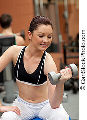 athletic woman with dumbbells - athletic woman working out...