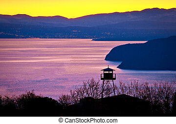 Lookout tower above Kvarner bay at golden dawn, Croatia
